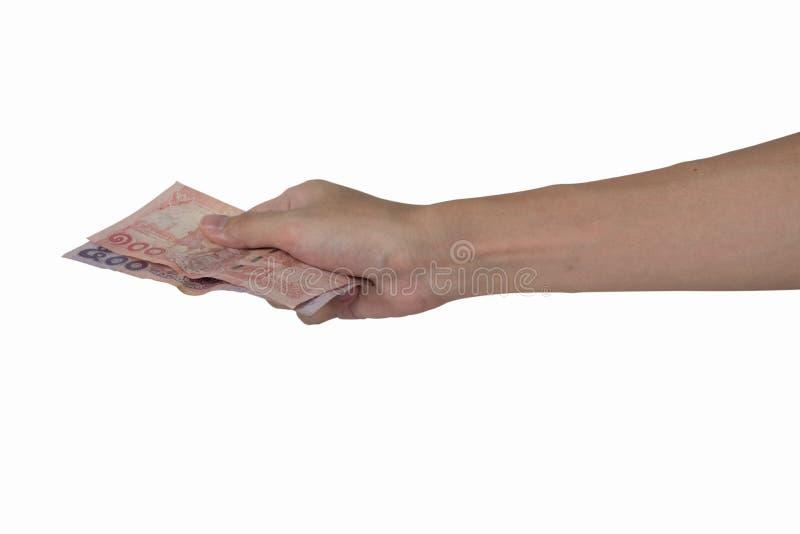 Closeupen räcker att ge thailändska pengar som isoleras på vit bakgrund, tr royaltyfri bild