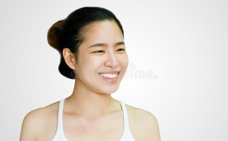 Closeupen till asiatiska en kvinnas framsida ler arkivbilder