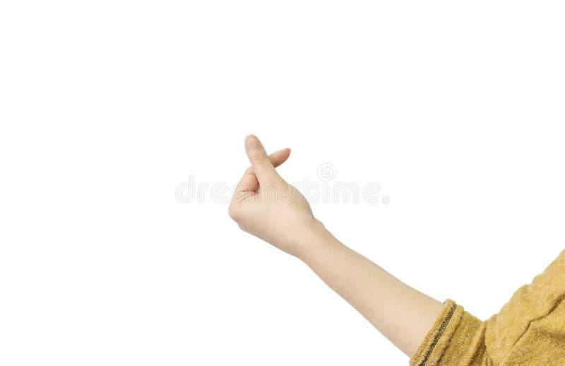 Closeuphandling av kvinnahanden i mini- hjärta vid pekfingret och tummen som isoleras på vit bakgrund med den snabba banan royaltyfri bild