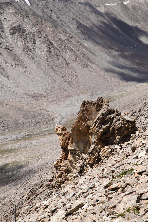 Closeview of fractured granite rock exposures at KhardungLa, Ladakh. A view from Khardung La or Khardung pass is the highest motorable road in the world stock photo