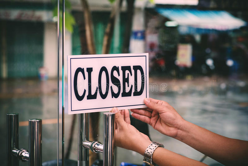Closing barbershop. Hands of hairstylist closing barbershop in the evening stock photos