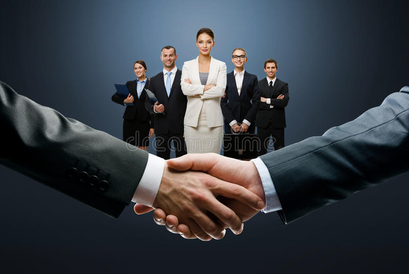 Closing deal with a handshake royalty free stock images