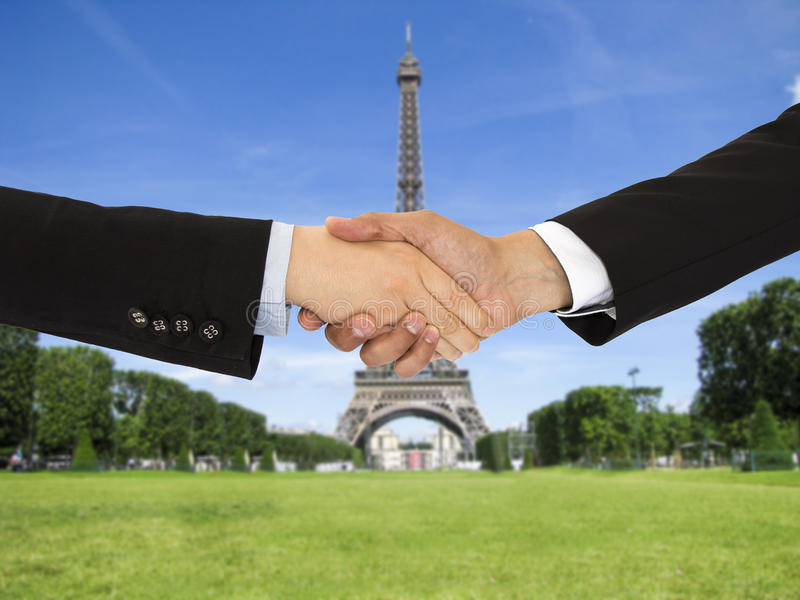 Closing a deal in Paris. Closing a deal with a handshake on a trip to Paris royalty free stock image