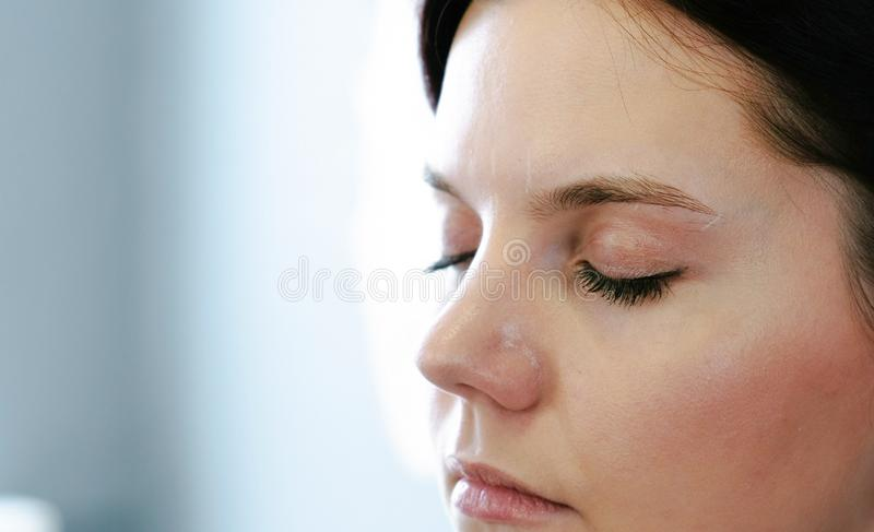 Closup fce of woman brunette looking down. Right on photo, side view. Closup fce of woman brunette looking down. Right on photo, side view stock images