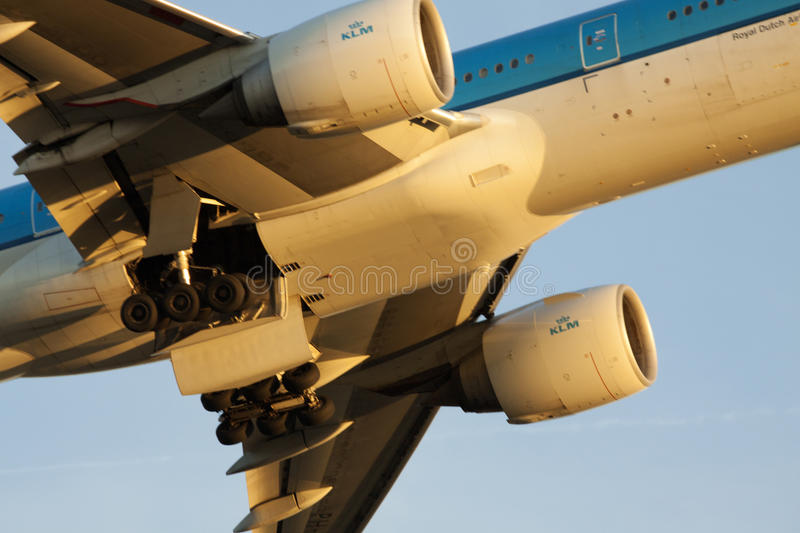 Closupphoto of a klm jet engine. Bottom plane of the wheels are not repealed and illuminated by sunlight stock photos