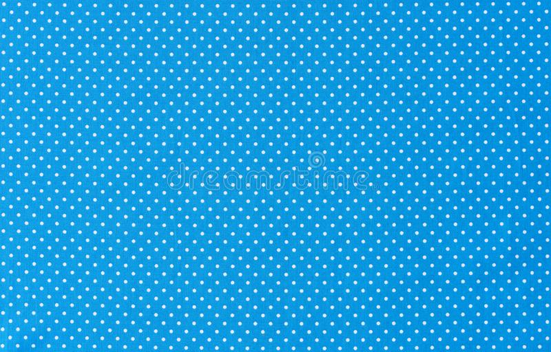 Light blue fabric background texture with polka dots pattern stock image