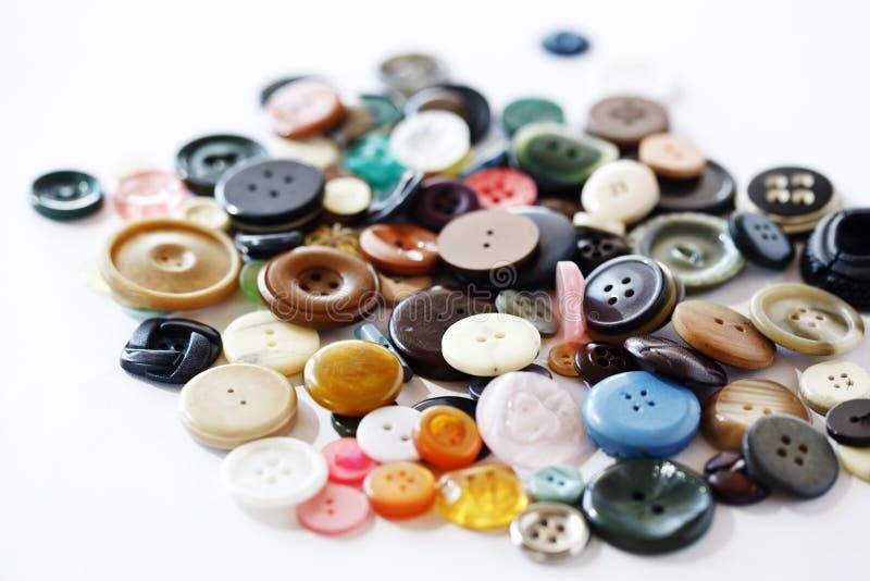 Cloth bottons (old) stock photos