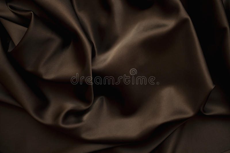 Cloth Chocolate brown satin silk close up stock photos