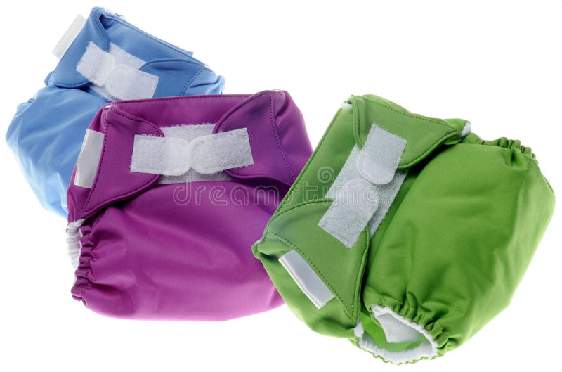 Cloth Diapers in Green, Purple and Blue stock photos