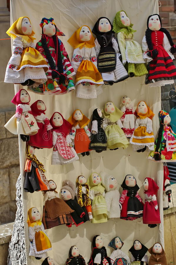 Traditional colored handmade cloth dolls, specific from Romania, in Romanian national costume stock photo