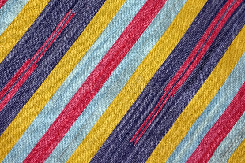 Textured knitted colorful diagonal stripes as background stock photos