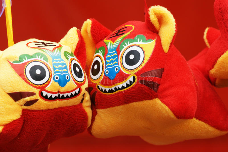 Cloth tigers. This year is the Year of the Tiger. People often buy some cartoon tigers to home to celebrate Chinese New Year(Spring Festival). Chinese character stock photo