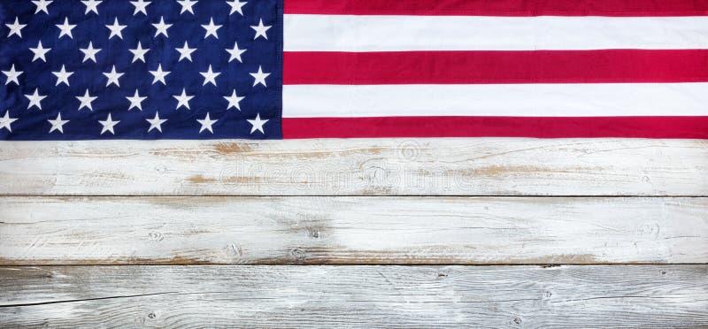 Cloth United States flag on white vintage wood plank background stock photos