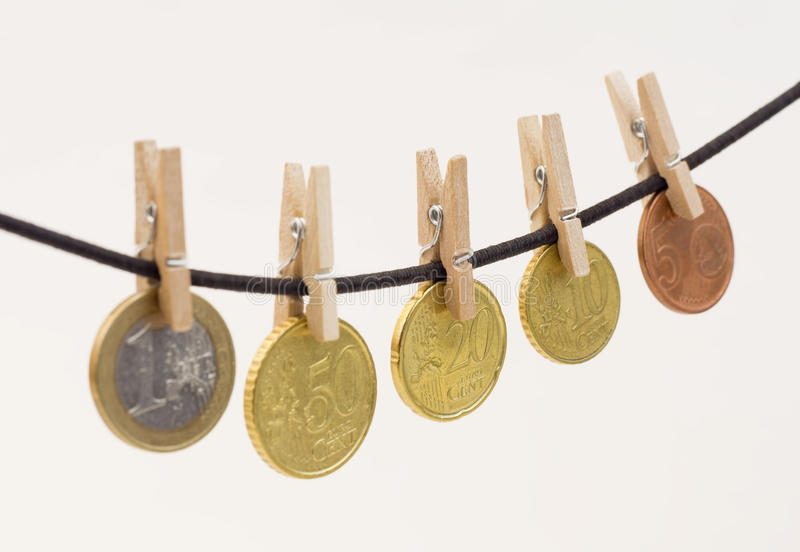Clothe spines with coins stock photos