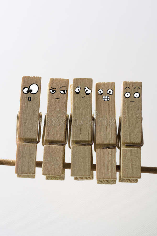 Clothe-spines with faces royalty free stock photography