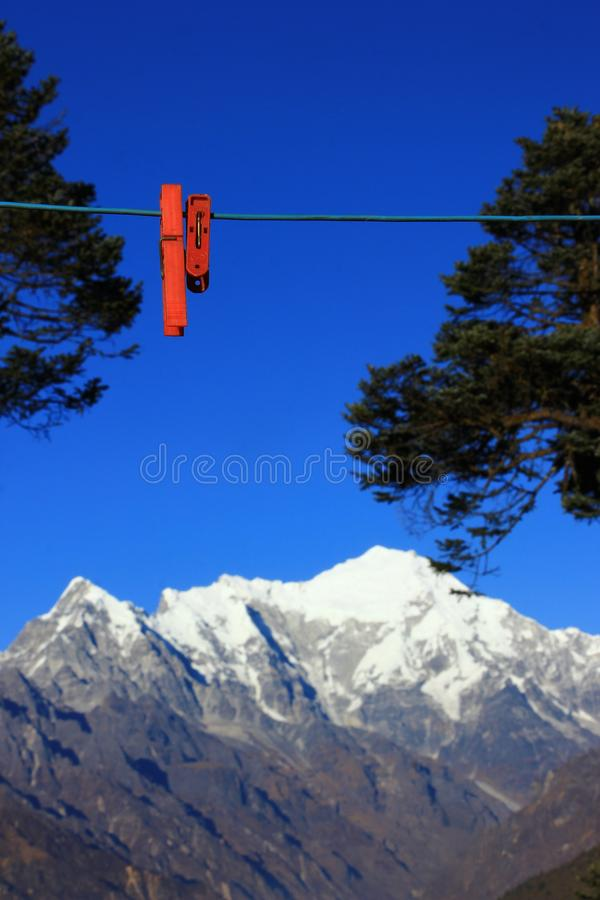 Clothepin on the rope with mountain background stock photo