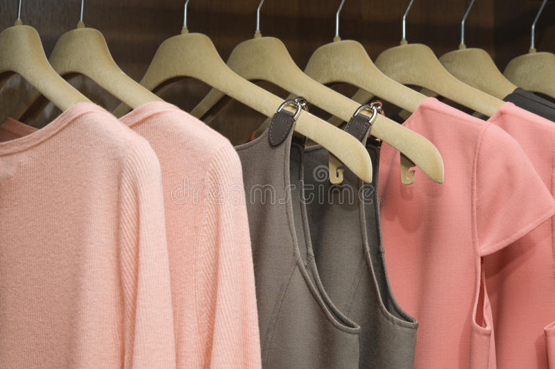Clothes. Colorful collection of women's clothes hanging on a rack stock photo