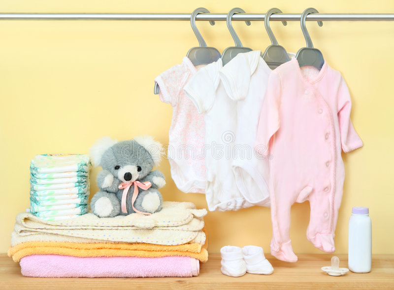 Clothes and accessories for newborn. Different clothes and accessories for newborn stock photography