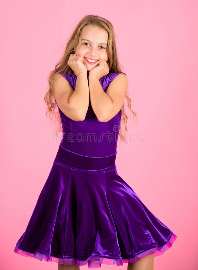Clothes for ballroom dance. Ballroom dancewear fashion concept. Kid dancer satisfied with concert outfit. Kids fashion. Kid fashionable dress looks adorable royalty free stock image