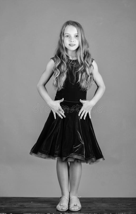 Clothes for ballroom dance. Kid fashionable dress looks adorable. Ballroom dancewear fashion concept. Kid dancer royalty free stock photo