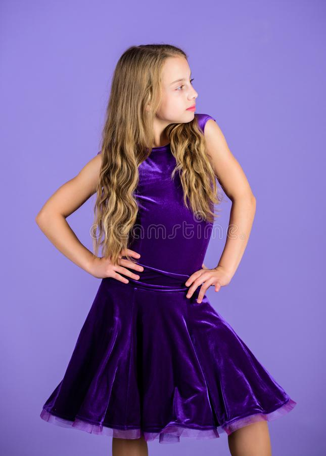 Clothes for ballroom dance. Kid fashionable dress looks adorable. Ballroom dancewear fashion concept. Kid dancer. Satisfied with concert outfit. Ballroom royalty free stock photography