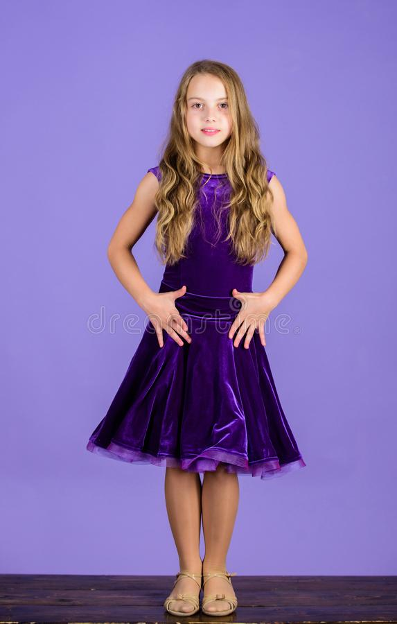 Clothes for ballroom dance. Kid fashionable dress looks adorable. Ballroom dancewear fashion concept. Kid dancer. Satisfied with concert outfit. Kids fashion royalty free stock photo