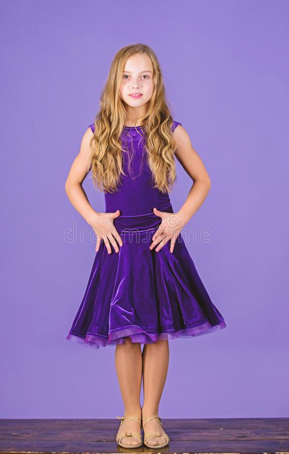 Clothes for ballroom dance. Kid fashionable dress looks adorable. Ballroom dancewear fashion concept. Kid dancer. Satisfied with concert outfit. Kids fashion royalty free stock image