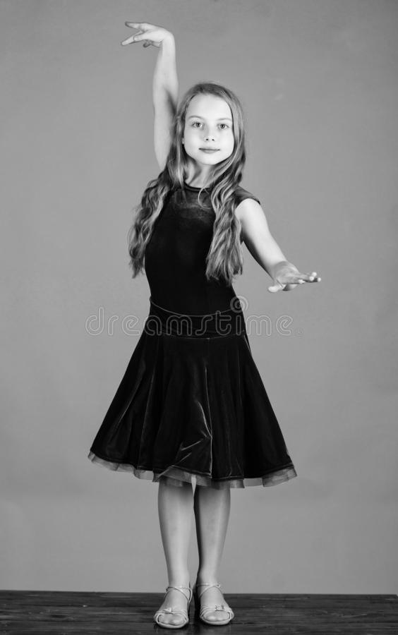Clothes for ballroom dance. Kids fashion. Kid fashionable dress looks adorable. Ballroom dancewear fashion concept. Kid. Dancer satisfied with concert outfit royalty free stock image