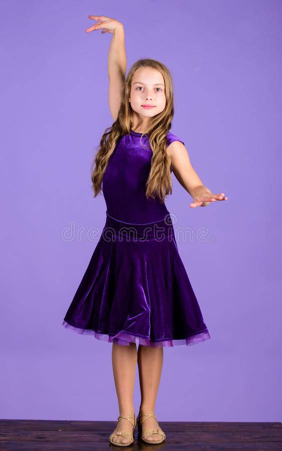 Clothes for ballroom dance. Kids fashion. Kid fashionable dress looks adorable. Ballroom dancewear fashion concept. Kid. Dancer satisfied with concert outfit royalty free stock photo