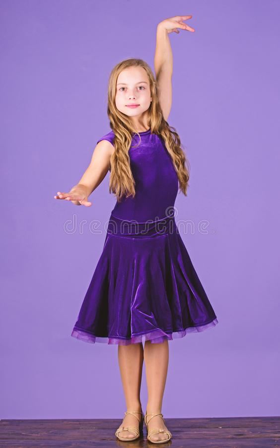 Clothes for ballroom dance. Kids fashion. Kid fashionable dress looks adorable. Ballroom dancewear fashion concept. Kid. Dancer satisfied with concert outfit stock photos