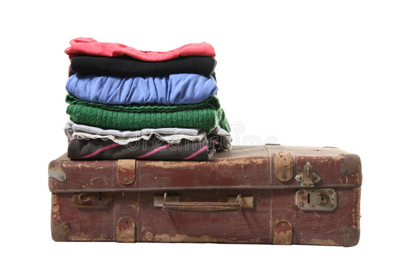 Clothes on brown retro suitcase. Isolated on white background royalty free stock image