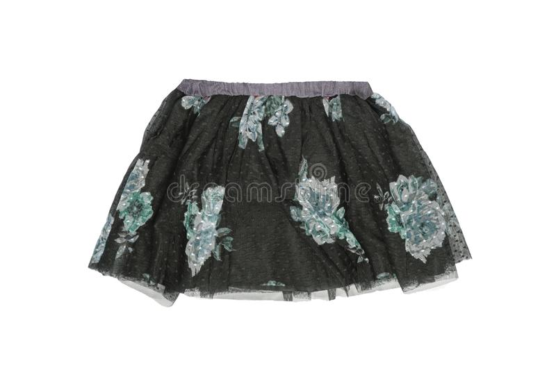 Clothes for children. Close-up of a beautiful black girl skirt with colorful pattern on black lace. Children spring and summer stock images
