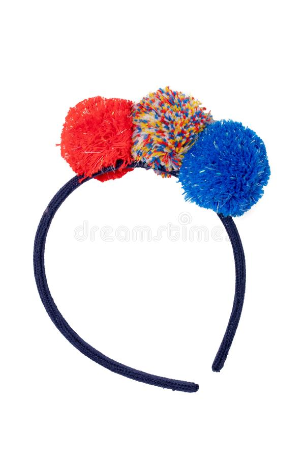 Clothes for children. Close-up of colored hairband with colorful fluffy fabric balls for the little girl isolated on a white stock photo