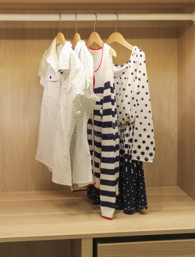 Clothes in the closet. Summer women's clothing in the closet on a hanger royalty free stock photography