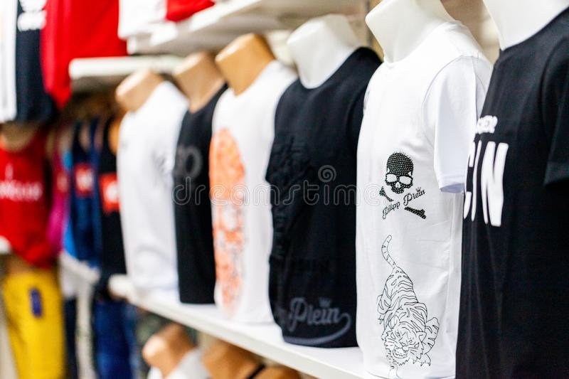 Clothes from diverse branches weared by puppets in a clothing store in Alanya, Turkey. ALANYA / TURKEY - JUNE 1, 2019: Clothes from diverse branches weared by royalty free stock photography