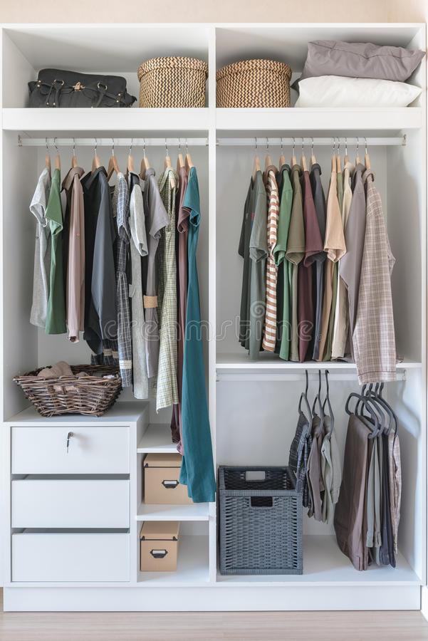 Download Clothes And Dress Hanging On Rail In White Closet Stock Photo    Image Of Textile