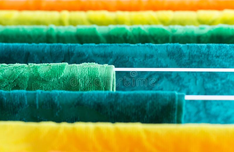 Clothes dryer with towels in sunlight stock images