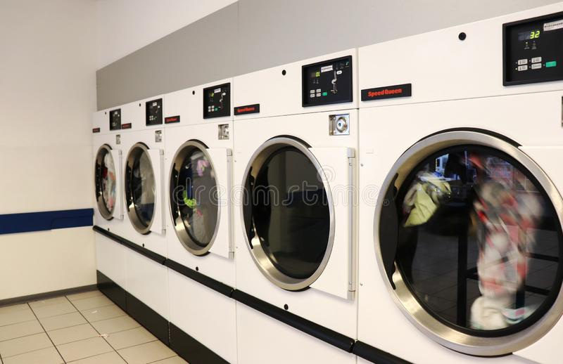 Clothes drying in a laundromat royalty free stock images