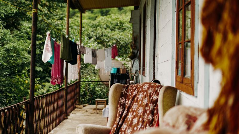 Clothes drying on rope line on a balcony - rural life stock photography