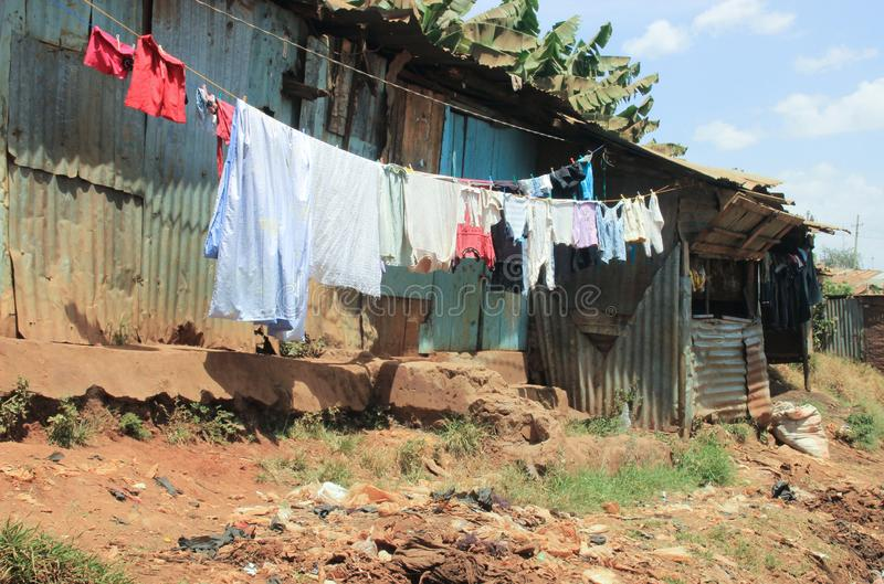 Clothes are drying on ropes in the slums of Nairobi - one of the poorest places stock photos