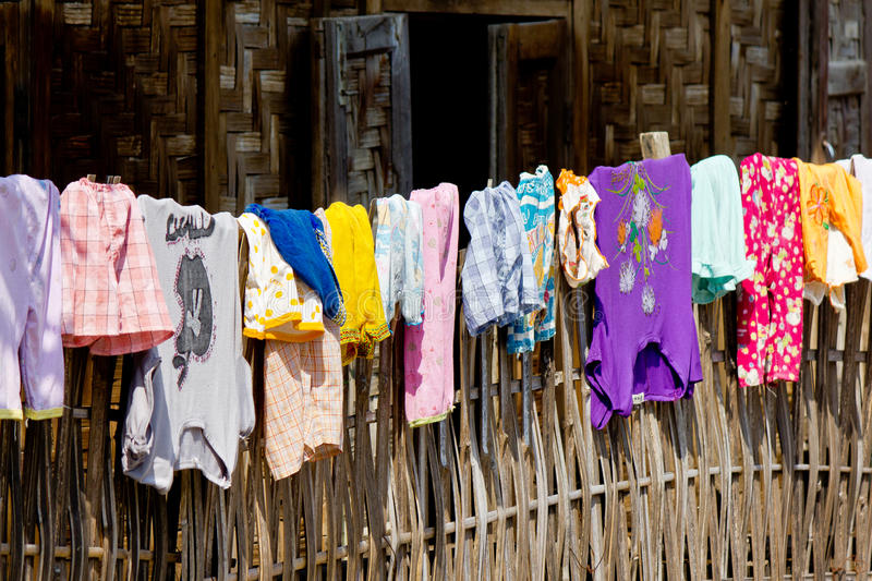 Clothes on a fence stock images