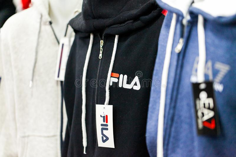 Clothes from Fila and Emporio Armani weared by a puppet in a clothing store in Alanya, Turkey. ALANYA / TURKEY - JUNE 1, 2019: Clothes from Fila and Emporio stock images
