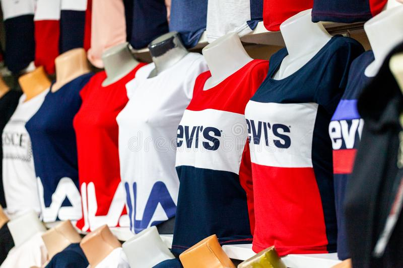 Clothes from Fila and Levis weared by puppets in a clothing store in Alanya, Turkey. ALANYA / TURKEY - JUNE 1, 2019: Clothes from Fila and Levis weared by royalty free stock images