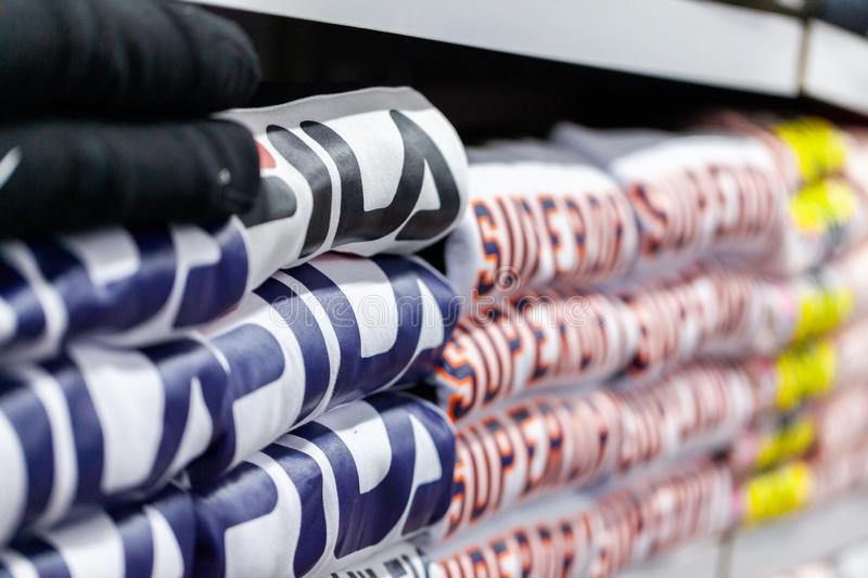 Clothes from Fila and Superdry lies in a clothing store in Alanya, Turkey. ALANYA / TURKEY - JUNE 1, 2019: Clothes from Fila and Superdry lies in a clothing stock images