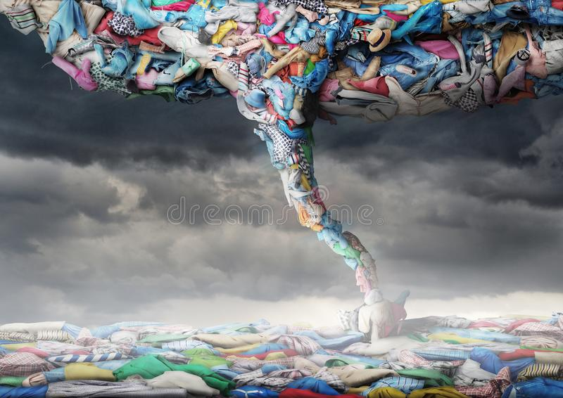 Clothes in the form of a tornado on a sky background. Clothing concept stock photos