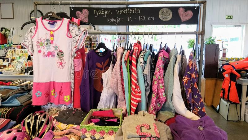 Clothes for girls at the flea market stock images