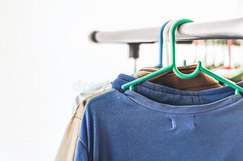 Clothes hang on a rack royalty free stock photography