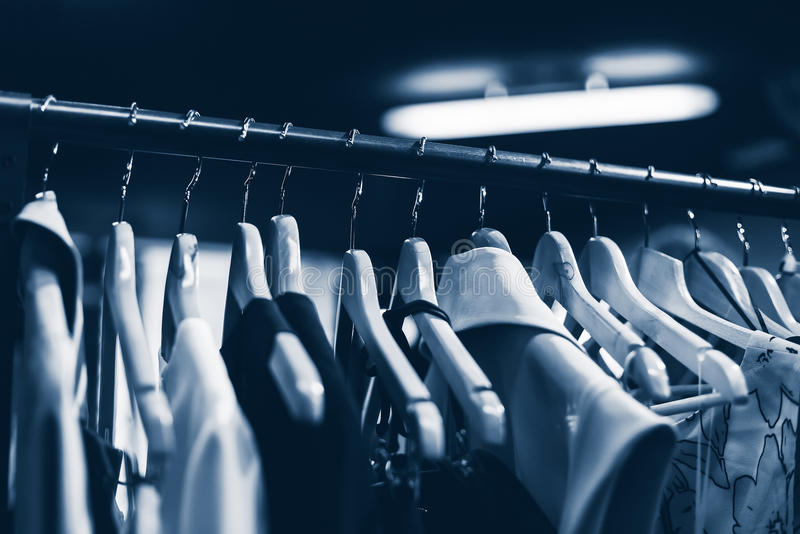Clothes hangers in fashion store. Clothes business concept. Blue. Selective focused royalty free stock images