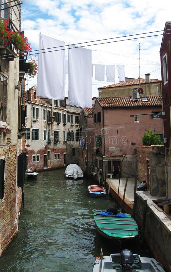 Clothes Hanging Out To Dry On A Canal Stock Photo