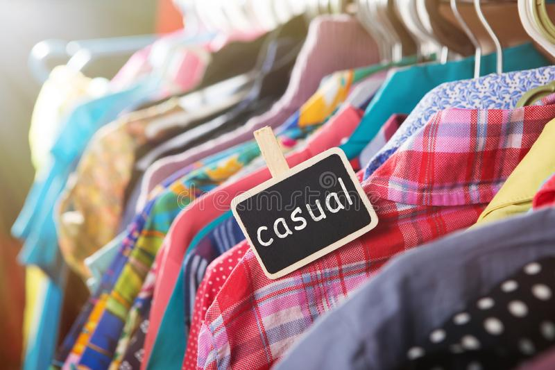 Clothes hanging on the rack in the store. Casual tag on Clothes hanging on the rack in the fashion store clothing label retail garment collection price shop stock photo
